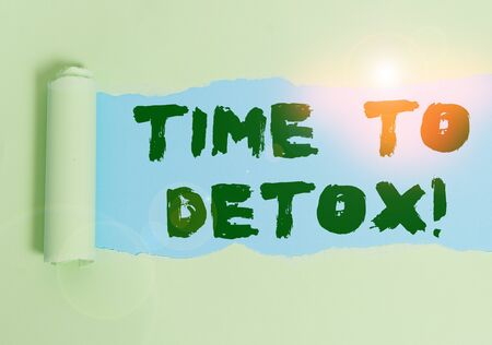 Word writing text Time To Detox. Business photo showcasing when you purify your body of toxins or stop consuming drug Cardboard which is torn in the middle placed above a plain table backdrop