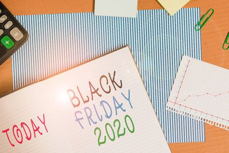 Handwriting text writing Black Friday 2020. Conceptual photo day following Thanksgiving Discounts Shopping day Striped paperboard notebook cardboard office study supplies chart paper