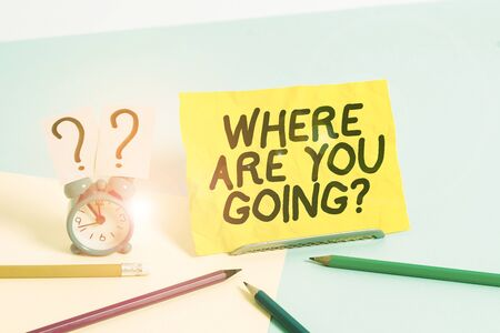Text sign showing Where Are You Goingquestion. Business photo text used to ask someone the destination headed to Mini size alarm clock beside stationary placed tilted on pastel backdrop