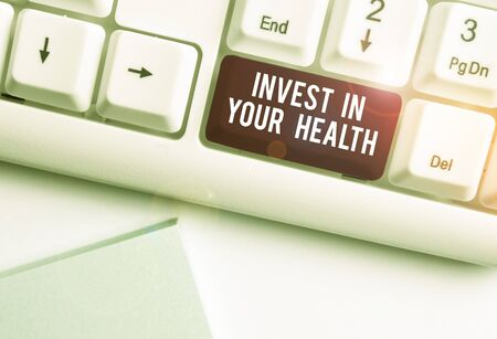Text sign showing Invest In Your Health. Business photo text Live a Healthy Lifestyle Quality Food for Wellness White pc keyboard with empty note paper above white background key copy space
