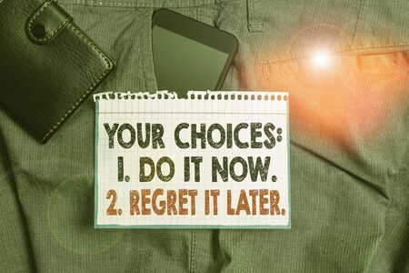 Writing note showing Your Choices 1 Do It Now 2 Regret It Later. Business concept for Think first before deciding Smartphone device inside trousers front pocket with wallet