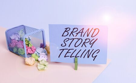 Writing note showing Brand Story Telling. Business concept for Breathing Life into a Brand an Engaging Content Trash bin crumpled paper clothespin reminder office supplies Archivio Fotografico
