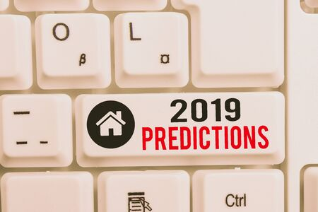 Word writing text 2019 Predictions. Business photo showcasing statement about what you think will happen in 2019 White pc keyboard with empty note paper above white background key copy space Reklamní fotografie
