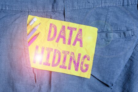 Word writing text Data Hiding. Business photo showcasing Secretly embedding data in graphics images and other file types Writing equipment and yellow note paper inside pocket of man work trousers Stock Photo