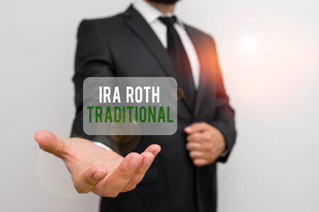 Handwriting text Ira Roth Traditional. Conceptual photo are tax deductible on both state and federal Male human with beard wear formal working suit clothes raising one hand up