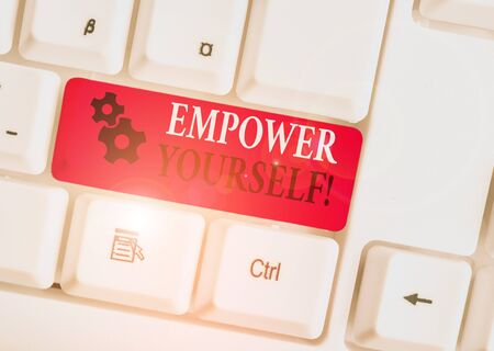 Conceptual hand writing showing Empower Yourself. Concept meaning taking control of our life setting goals and making choices White pc keyboard with note paper above the white background