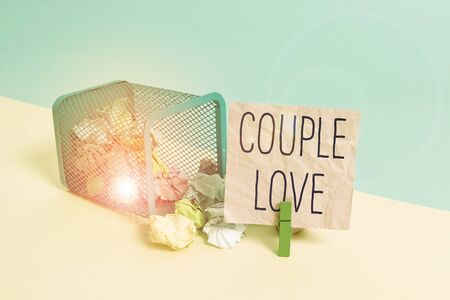 Conceptual hand writing showing Couple Love. Concept meaning two showing who love each other very much Feeling pleasure Trash bin crumpled paper clothespin reminder office supplies