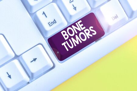 Word writing text Bone Tumors. Business photo showcasing can be either benign or malignant growths found in the bone White pc keyboard with empty note paper above white background key copy space