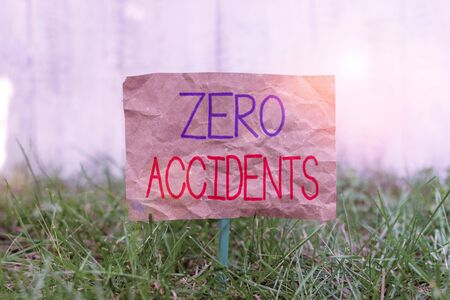 Word writing text Zero Accidents. Business photo showcasing important strategy for preventing workplace accidents Crumpled paper attached to a stick and placed in the green grassy land