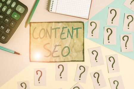 Writing note showing Content Seo. Business concept for creating webpage content to rank high in the search engines Mathematics stuff and writing equipment above pastel colours background