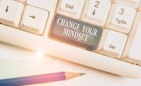 Conceptual hand writing showing Change Your Mindset. Concept meaning replace your beliefs way of thinking mental path White pc keyboard with note paper above the white background