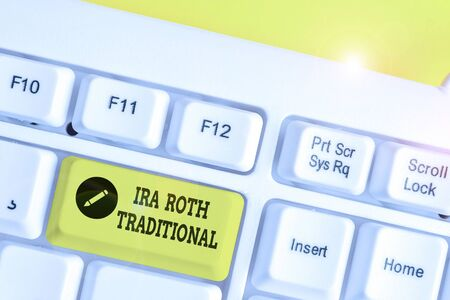 Conceptual hand writing showing Ira Roth Traditional. Concept meaning are tax deductible on both state and federal White pc keyboard with note paper above the white background