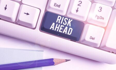 Text sign showing Risk Ahead. Business photo showcasing A probability or threat of damage, injury, liability, loss White pc keyboard with empty note paper above white background key copy space Reklamní fotografie