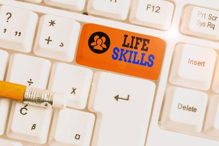 Text sign showing Life Skills. Business photo showcasing skill that is necessary for full participation in everyday life White pc keyboard with empty note paper above white background key copy space