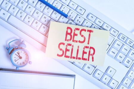 Conceptual hand writing showing Best Seller. Concept meaning new book or other product that has sold a great number of copies Flat lay above empty note paper on pc keyboard pencils and clock Stockfoto