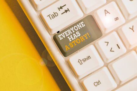 Text sign showing Everyone Has A Story. Business photo text account of past events in someones life or career White pc keyboard with empty note paper above white background key copy space