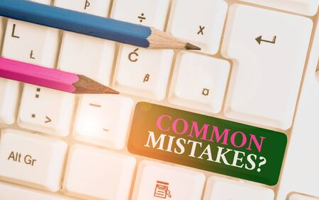 Text sign showing Common Mistakes Question. Business photo showcasing repeat act or judgement misguided making something wrong White pc keyboard with empty note paper above white background key copy space Reklamní fotografie