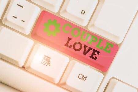 Conceptual hand writing showing Couple Love. Concept meaning two showing who love each other very much Feeling pleasure White pc keyboard with note paper above the white background