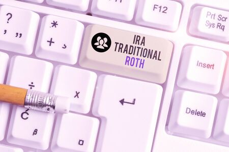 Conceptual hand writing showing Ira Traditional Roth. Concept meaning are tax deductible on both state and federal White pc keyboard with note paper above the white background