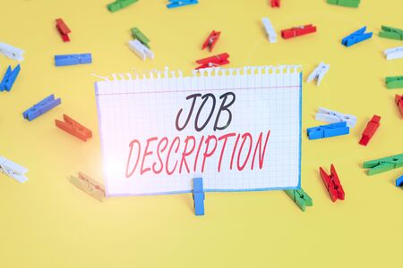Writing note showing Job Description. Business concept for a formal account of an employee s is responsibilities Colored clothespin papers empty reminder yellow floor background office