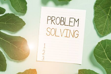 Conceptual hand writing showing Problem Solving. Concept meaning process of finding solutions to difficult or complex issues Leaves surrounding notepaper above empty soft pastel table