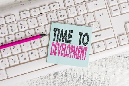 Writing note showing Time To Development. Business concept for a length of time during which a company grows or develop Keyboard office supplies rectangle shape paper reminder wood