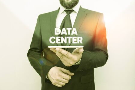 Word writing text Data Center. Business photo showcasing a repository that houses computing facilities like servers Male human wear formal work suit hold smart hi tech smartphone use one hand Stok Fotoğraf