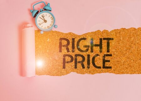 Text sign showing Right Price. Business photo showcasing the amount of money that it is reasonable for the product Alarm clock and torn cardboard placed above a wooden classic table backdrop Stok Fotoğraf - 133738518