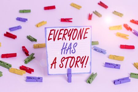 Handwriting text Everyone Has A Story. Conceptual photo account of past events in someones life or career Colored clothespin papers empty reminder white floor background office