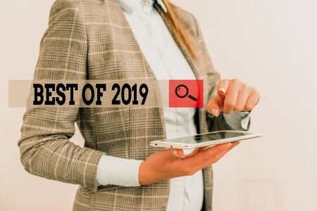 Text sign showing Best Of 2019. Business photo showcasing great and marvelous things and events happened on 2019 Business concept with mobile phone and business woman Imagens