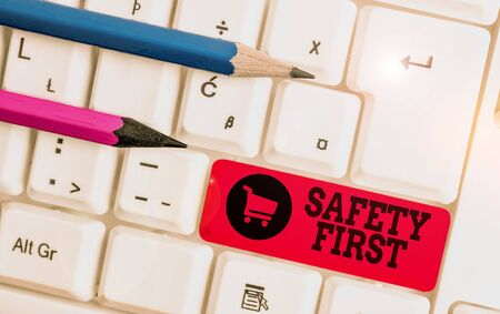 Writing note showing Safety First. Business concept for used to say that the most important thing is to be safe White pc keyboard with note paper above the white background Reklamní fotografie