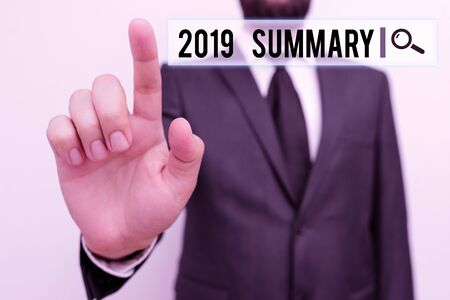 Text sign showing 2019 Summary. Business photo showcasing brief comprehensive especially covering the main points of 2019 Male human with beard wear formal working suit clothes raising one hand up