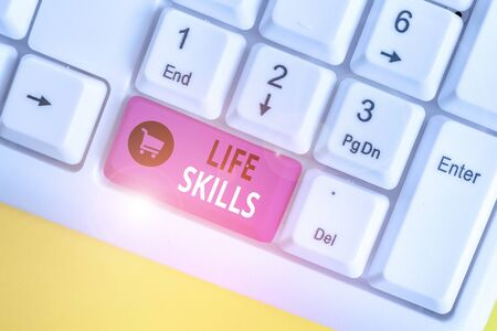 Handwriting text Life Skills. Conceptual photo skill that is necessary for full participation in everyday life White pc keyboard with empty note paper above white background key copy space Stock Photo