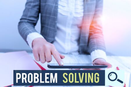 Conceptual hand writing showing Problem Solving. Concept meaning process of finding solutions to difficult or complex issues Business concept with mobile phone in the hand