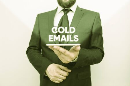 Word writing text Cold Emails. Business photo showcasing unsolicited email sent to a receiver without prior contact Male human wear formal work suit hold smart hi tech smartphone use one hand Stock Photo