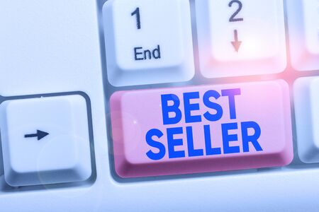 Handwriting text Best Seller. Conceptual photo new book or other product that has sold a great number of copies White pc keyboard with empty note paper above white background key copy space