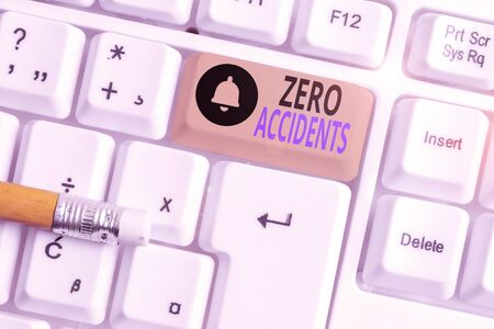 Writing note showing Zero Accidents. Business concept for important strategy for preventing workplace accidents White pc keyboard with note paper above the white background