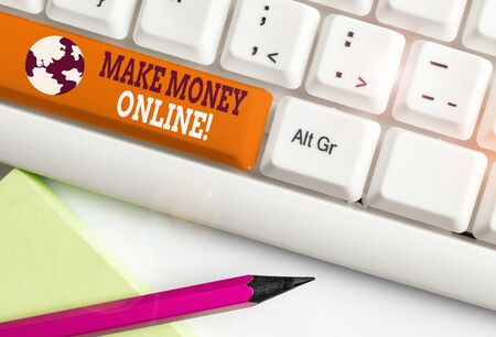 Writing note showing Make Money Online. Business concept for making profit using internet like freelancing or marketing White pc keyboard with note paper above the white background