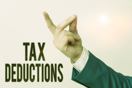 Handwriting text Tax Deductions. Conceptual photo an amount or cost that subtracted from someone s is income Isolated hand pointing with finger. Business concept pointing finger