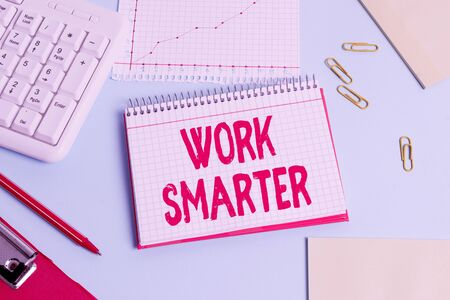 Handwriting text Work Smarter. Conceptual photo figuring out order to reach goals in the most efficient way Paper blue desk computer keyboard office study notebook chart numbers memo