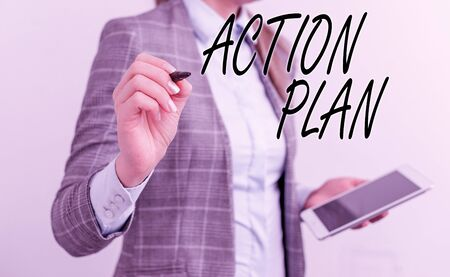 Handwriting text writing Action Plan. Conceptual photo detailed plan outlining actions needed to reach goals or vision Business woman pointing in empty space with pen and mobile phone