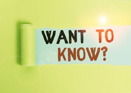 Text sign showing Want To Know Question. Business photo text Request for information Asking Wonder Need Knowledge Cardboard which is torn in the middle placed above a plain table backdrop