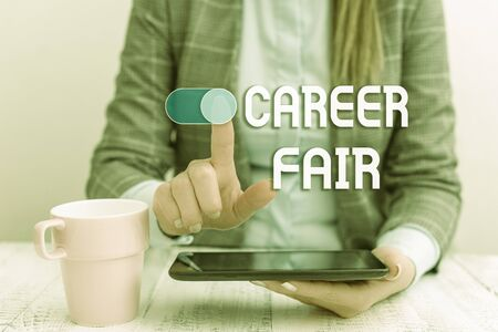 Text sign showing Career Fair. Business photo text an event at which job seekers can meet possible employers Business woman sitting with mobile phone and cup of coffee on the table Imagens