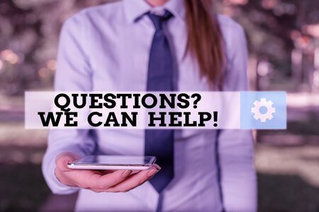 Conceptual hand writing showing Questionsquestion We Can Help. Concept meaning offering help to those who wants to know Business woman in shirt holding laptop and mobile phone Standard-Bild - 133474487