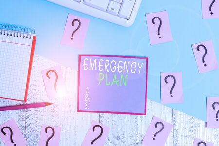 Handwriting text Emergency Plan. Conceptual photo procedures for handling sudden or unexpected situations Writing tools, computer stuff and math book sheet on top of wooden table 스톡 콘텐츠