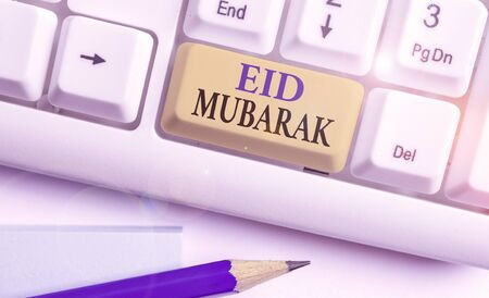 Conceptual hand writing showing Eid Mubarak. Concept meaning traditional Muslim greeting reserved for the holy festivals