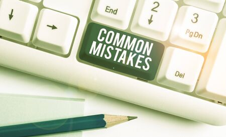 Text sign showing Common Mistakes. Business photo showcasing actions that are often used interchangeably with error White pc keyboard with empty note paper above white background key copy space
