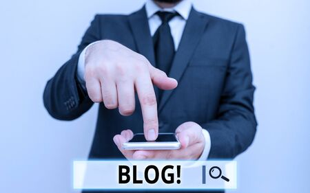 Text sign showing Blog. Business photo text regularly updated website web page run by individual or group Male human wear formal work suit hold smart hi tech smartphone use one hand Reklamní fotografie