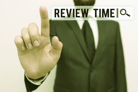 Text sign showing Review Time. Business photo showcasing to think or talk about something again Set schedule to review Male human with beard wear formal working suit clothes raising one hand up