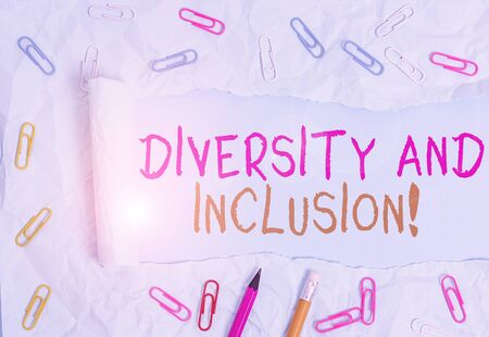 Conceptual hand writing showing Diversity And Inclusion. Concept meaning range huanalysis difference includes race ethnicity gender Stationary and torn cardboard on a plain pastel table backdrop